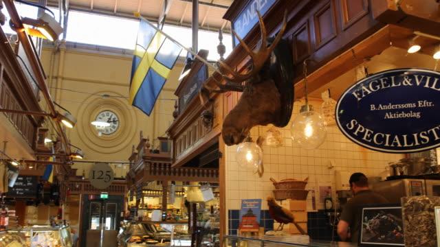 östermalms saluhall in stockholm, sweden - schweden stock-videos und b-roll-filmmaterial