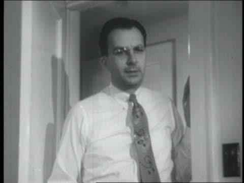 b/w 1954 stern man wearing eyeglasses standing at door - 1954 stock videos & royalty-free footage