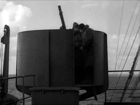 two destroyers on ocean antiaircraft gunners in ship's turret ws ships on ocean tu ws american flag flying on stern pole of ship ws hms dido frigate... - anno 1941 video stock e b–roll