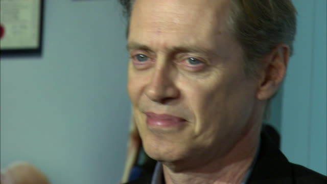 ms steve buscemi posing for paparazzi on the red carpet - steve buscemi stock videos and b-roll footage