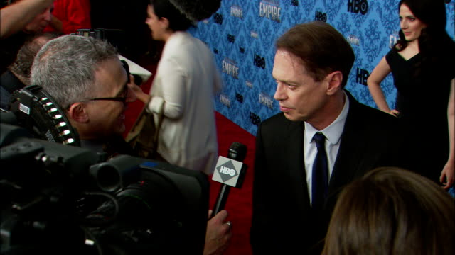 steve buscemi talking to hbo correspondent on the red carpet at the ziegfeld theater - steve buscemi stock videos & royalty-free footage
