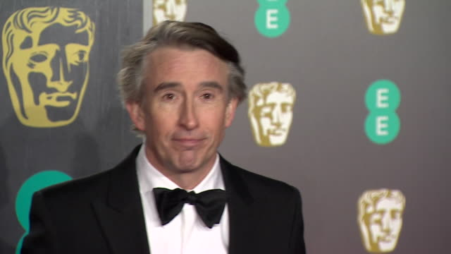 steve coogan poses for photos on red carpet at bafta film awards at royal albert hall - royal albert hall点の映像素材/bロール