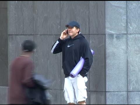 steve guttenberg chats before entering reebok sports center in new york 04/26/11 - スティーヴ グッテンバーグ点の映像素材/bロール