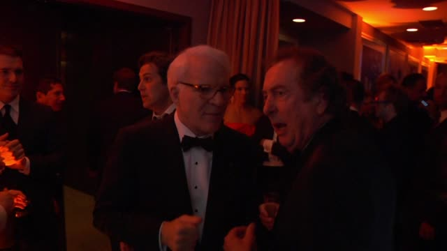 steve martin and eric idle at the inside the vanity fair oscar party 2010 at west hollywood ca - eric idle stock-videos und b-roll-filmmaterial