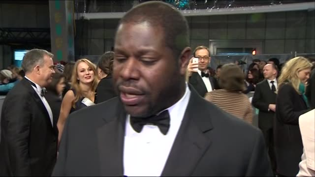 steve mcqueen describes chiwetel ejiofor during red carpet interview at the baftas 2014 - 2014 stock videos & royalty-free footage