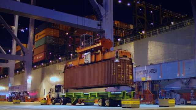 stevedores loading ship at night - cargo container stock videos & royalty-free footage