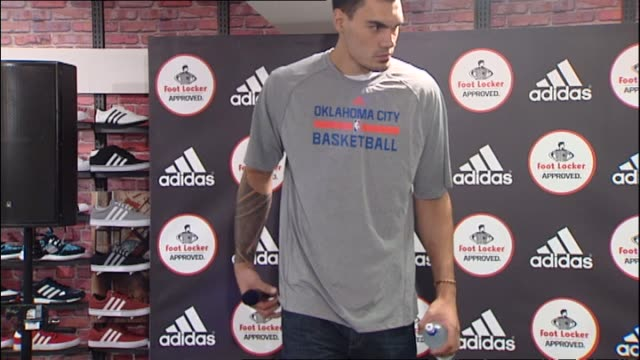 Steven Adams making entrance at publicity event held at Foot Locker retail store in 2014