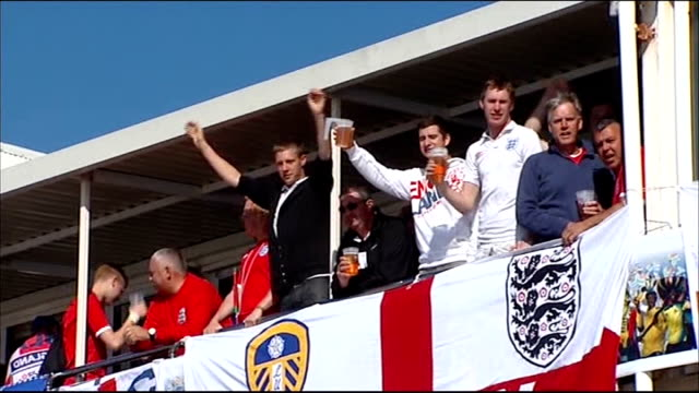steven gerrard says england players deserve to be booed june 2010 england fans cheering and waving england flags outside bar during 2010 world cup... - fußballweltmeisterschaft 2010 stock-videos und b-roll-filmmaterial