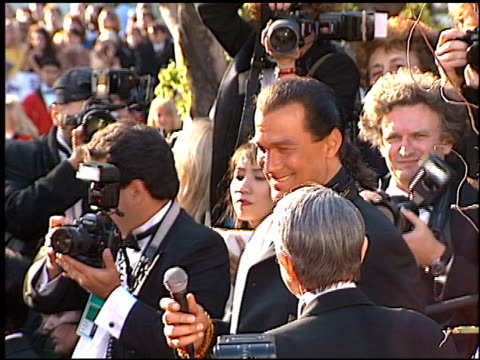 vídeos de stock, filmes e b-roll de steven seagal at the 1996 academy awards arrivals at the shrine auditorium in los angeles california on march 25 1996 - 1996