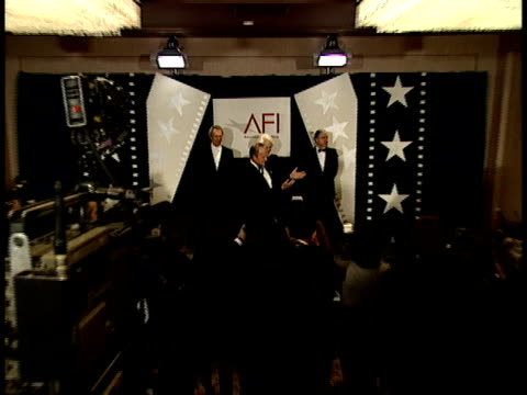 Steven Spielberg presents Clint Eastwood with his award