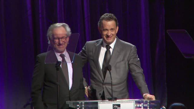 Steven Spielberg Tom Hanks joke about their wives at the An Unforgettable Evening Benefiting EIF's Women's Cancer Research Fund at Beverly Hills CA