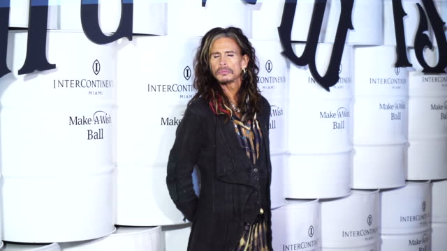 steven tyler of aerosmith poses for photographers on the red carpet of the make a wish foundation's ball in miami at the intercontinental hotel - intercontinental hotels group stock videos & royalty-free footage