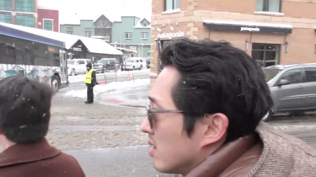Steven Yeun on Main Street at the Sundance Film Festival in Park City Utah at Celebrity Sightings in Park City on January 20 2018 in Park City Utah