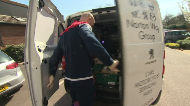 stevenage fc captain scott cuthbert delivering food to the local community during the coronavirus crisis - support stock videos & royalty-free footage