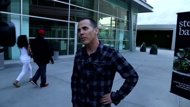 steve-o talks about another jackass movie while playing hacky sack while leaving arclight theatre in hollywood in celebrity sightings in los angeles, - steve o stock videos & royalty-free footage