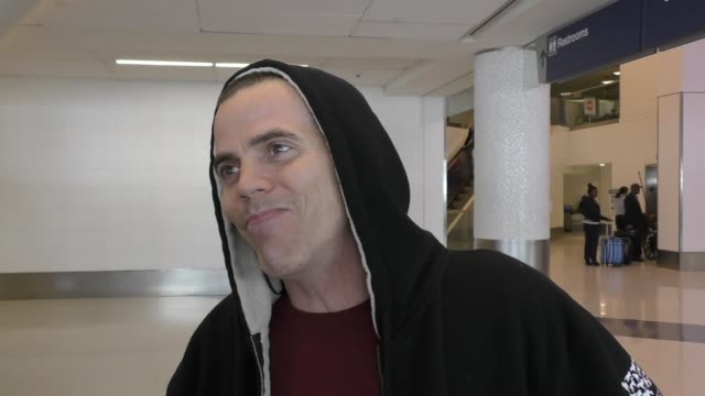 steve-o talks about his thoughts on death while departing at lax airport in los angeles in celebrity sightings in los angeles, - steve o stock videos & royalty-free footage