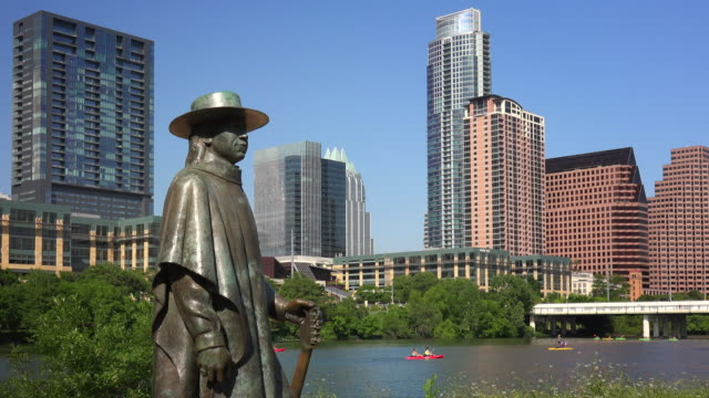 Stevie Ray Vaughan Statue in Front of Downtown Austin, Texas and Colorado River