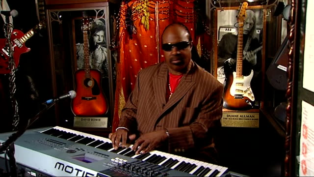 stevie wonder interview on his forthcoming tour; england: london: hard rock cafe: int musician and songwriter stevie wonder sat playing keyboard - songwriter stock videos & royalty-free footage