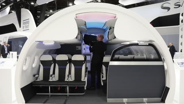 steward showing model of passenger cabin at paris airshow paris îledefrance france on tuesday june 18 2019 - air stewardess stock videos & royalty-free footage