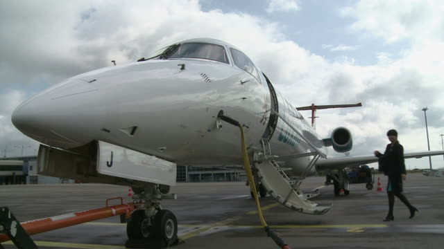 ws stewardess boarding airplane at findel airport / luxembourg - 給油点の映像素材/bロール