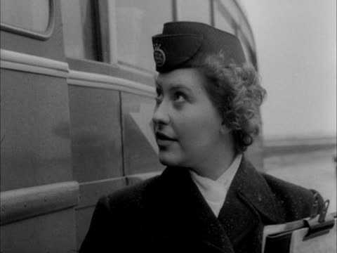 a stewardess counts passengers off an aircraft bus - air stewardess stock videos & royalty-free footage
