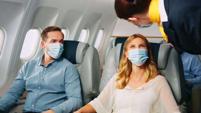 stewardess in airplane - mid air stock videos & royalty-free footage
