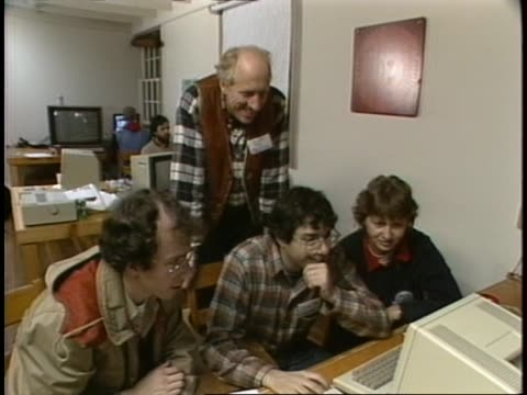 stewart brand observes people working on a project on an apple macintosh and printer - hacker stock videos and b-roll footage