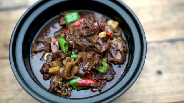 stewed beef with chili pepper in dish - meal stock videos and b-roll footage