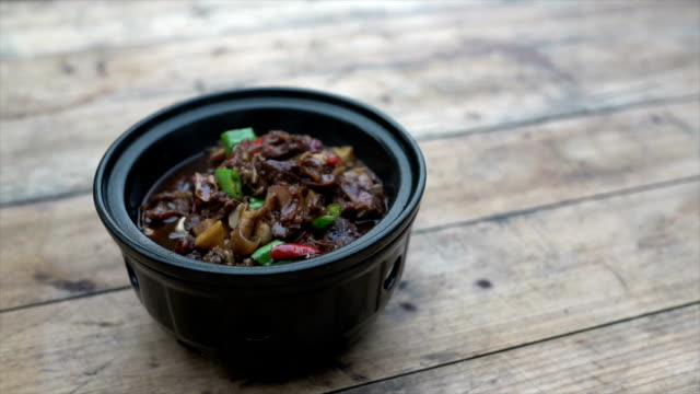 stewed beef with chili pepper in dish - braised stock videos and b-roll footage