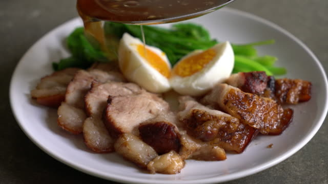 stewed pork leg with egg and vegetable - braised stock videos and b-roll footage