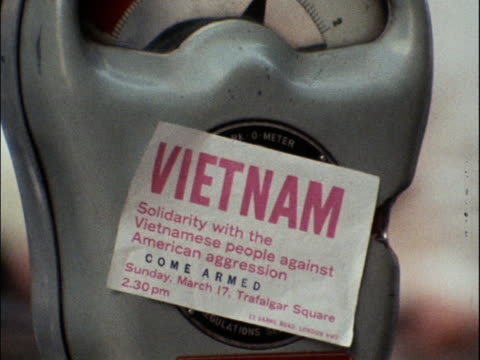 a sticker promoting an antivietnam war demonstration at trafalgar square is placed on a parking meter - 1968 stock videos & royalty-free footage