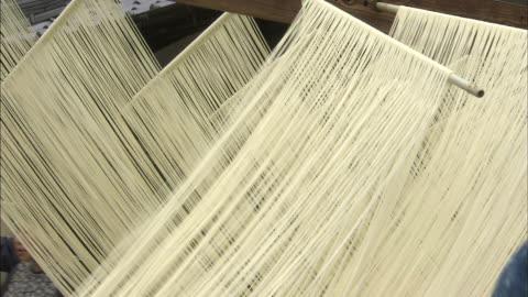 sticks shake racks of drying somen noodles. - noodles stock videos & royalty-free footage