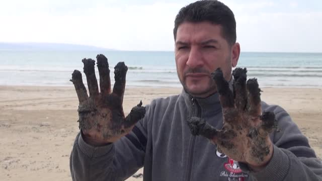 sticky dark tar washes up on the shore of the the lebanese southern coastal city of tyre after a suspected oil tanker leak off the coast of israel - sticky stock videos & royalty-free footage