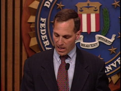 still at a press conference held in washington dc in 1999 fbi director louis freech discusses the physical appearance of osama bin laden in hopes of... - brown eyes stock videos & royalty-free footage
