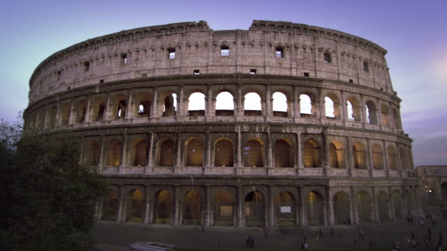 still footage of colosseum and constantine's arch at dusk - arch of constantine stock videos and b-roll footage
