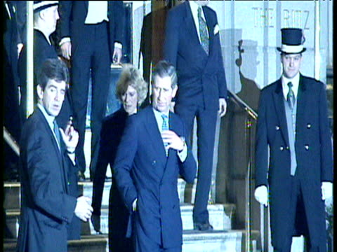 still freeze of camilla parkerbowles and prince charles stepping out of ritz hotel the first time they appeared together as a couple in public 29 jan... - camilla duchess of cornwall stock videos and b-roll footage