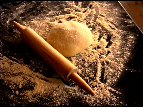 Still life of rolling pin and dough