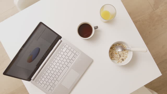 still life working home at  breakfast at home at kitchen table - table top view stock videos & royalty-free footage