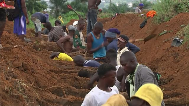 600 still missing after mudslides that killed at least 450 people LIB / 1782017 Graves being dug Men in protective clothing carrying coffin of...