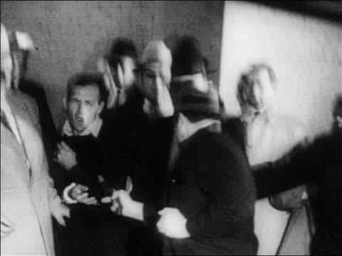 B/W 1963 still of Jack Ruby shooting killing Lee Harvey Oswald indoors / newsreel