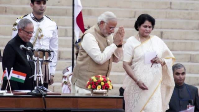 vídeos de stock, filmes e b-roll de still photo montage of narendra modi being sworn in as prime minister of india - primeiro ministro