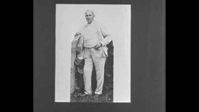 Still photo of American inventor Thomas Edison listening to his phonograph machine / VS still photos of Edison / VS writings of Edison / VS more...