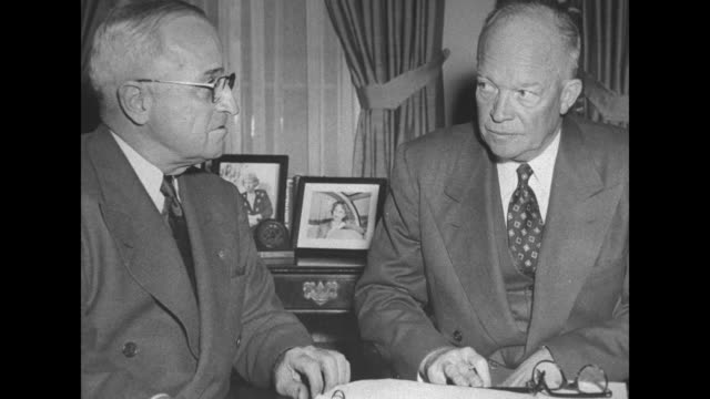 stockvideo's en b-roll-footage met still photo of pres harry truman sitting at desk in oval office of white house with presidentelect dwight eisenhower / shot of exterior of white... - styles bridges