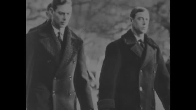 still prince albert, duke of york, walks with king edward viii during the procession of their father king george v's coffin from sandringham house to... - エドワード8世点の映像素材/bロール