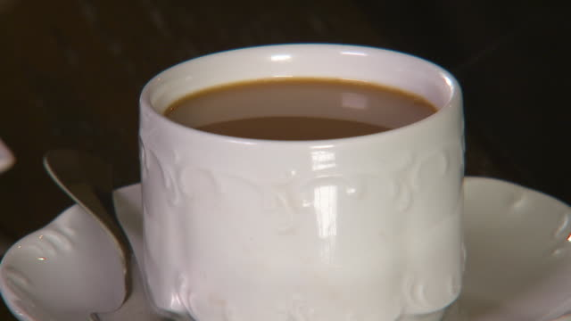 still shot of a cup of coffee on a saucer - saucer stock videos & royalty-free footage