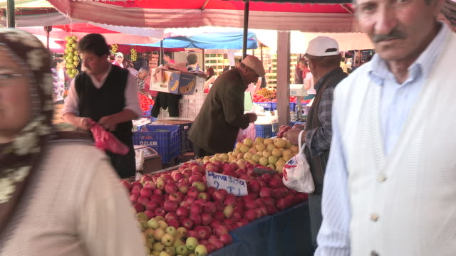 still shot of a fruit vendor and shoppers no - turks fruit stock videos and b-roll footage