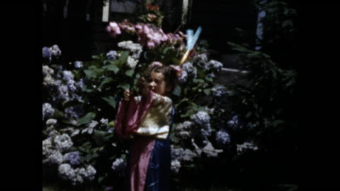 still shot of a little girl wearing a pink kimono; she holds flowers branch in one and fishing rod with fake fish in the other; flower bush in the... - one girl only stock videos & royalty-free footage