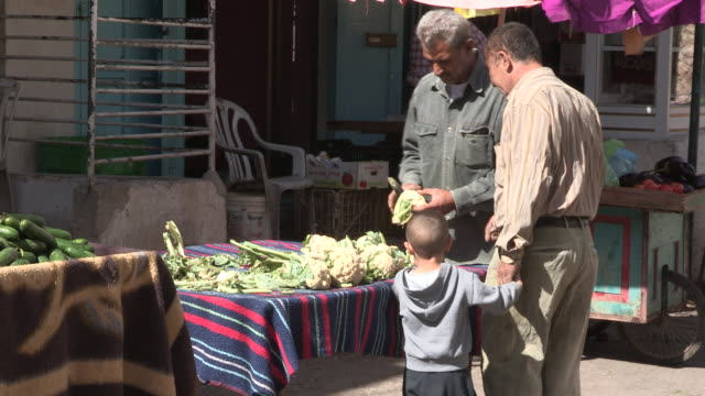 still shot of a man and his son buying vegetables. - single father stock videos & royalty-free footage