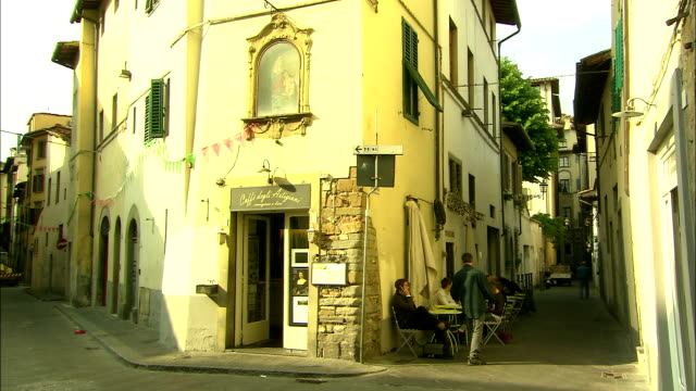 still shot of a man leaving a café - florence italy stock videos and b-roll footage