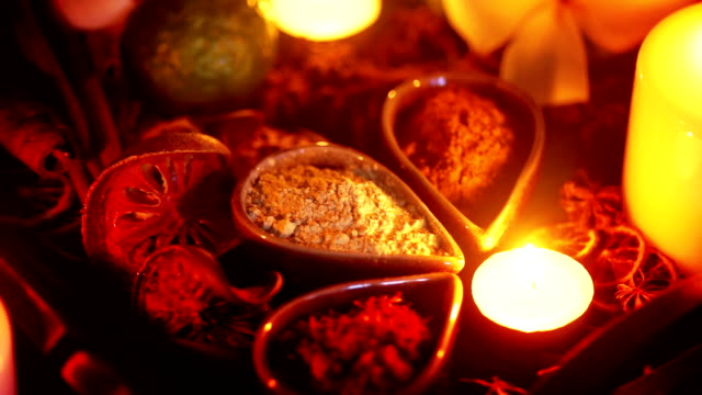 Still shot of A set of herbal treatments for massage and spa decorated with Frangipani and lighting candles.